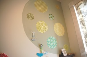Fabric circles were adhered to the wall with a spray adhesive.